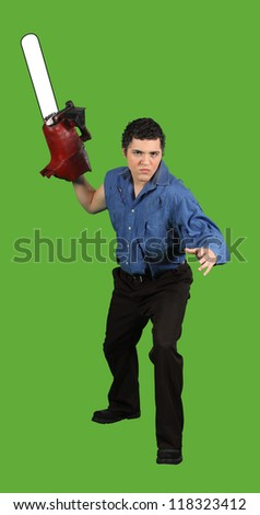 A man with a chainsaw threatens you with violence - stock photo