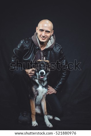 A man with a dog on a black background
