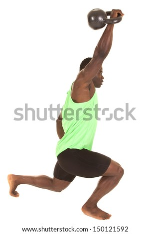 A man with a kettle bell up in the air. - stock photo