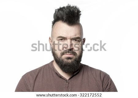 A man with a mohawk and beard, isolated - stock photo