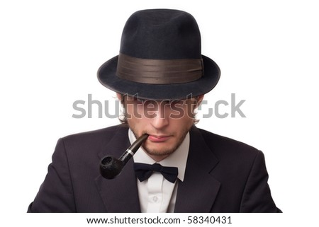 a man with a pipe in classical hat - stock photo