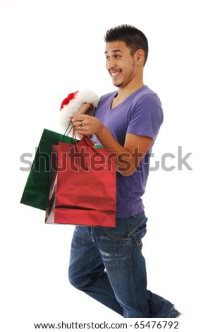 A man with a Santa hat and Christmas gifts laughing