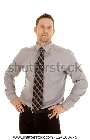 A man with a serious expression on his face wearing a tie and is ready for work. - stock photo