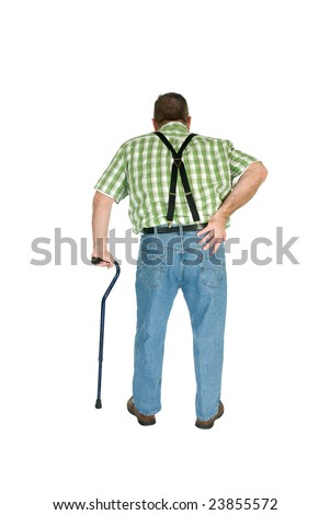 A man with back pain walks with the assistance of a cane. - stock photo