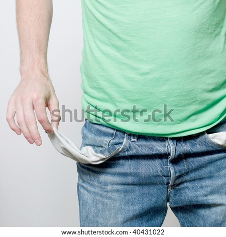 A man with empty pockets - stock photo