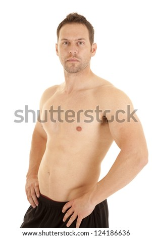 A man with his hands on his hips with a serious expression on his face, - stock photo