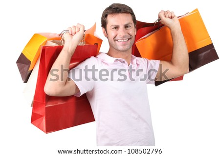 A man with plenty of shopping bags. - stock photo