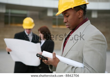 A man working as  architects on a construction site - stock photo