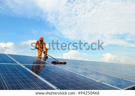 A man  working at solar  power  station