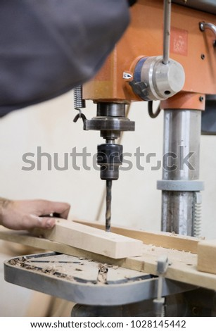 A man working with a drill.