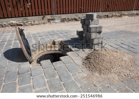A manhole cover for a sanitary sewer access point - stock photo