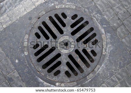 A manhole cover in the city of Tel Aviv. - stock photo