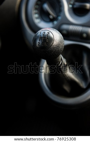A manual shift car gear lever - stock photo
