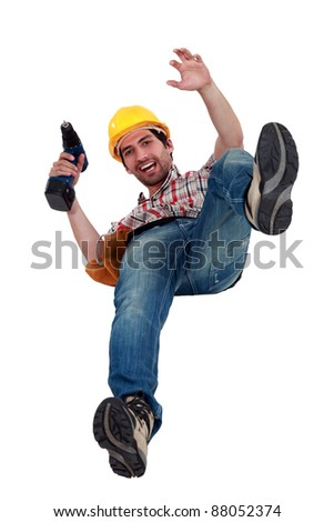 A manual worker falling. - stock photo