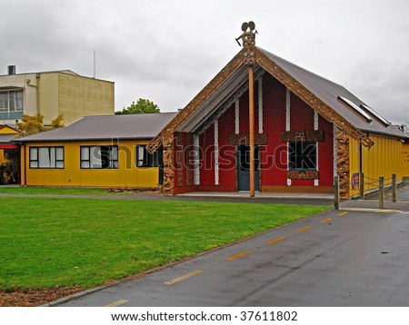 A Maori Whare(meeting house) on a New Zealand college campus - stock photo