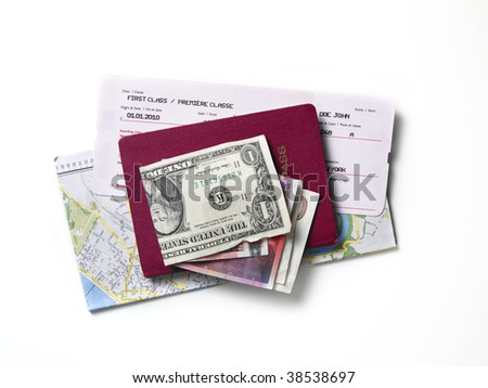 A map, a passport, a flight ticket, differnt currencys on a white surface. - stock photo