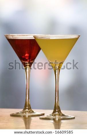 A margerita and cosmopolitan Cocktail drink on a bar top. - stock photo