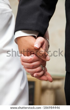 A married couple holding hands.  - stock photo
