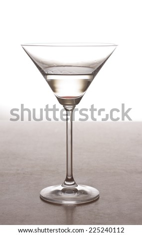 A martini cocktail in a martini glass against a white background  - stock photo
