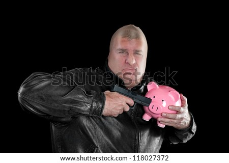 A masked thief threatening to shoot a piggy bank as he steals it during a bad economy.