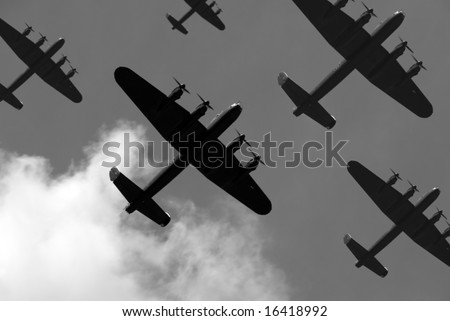 A massed formation of British Lancaster bombers flying overhead. - stock photo