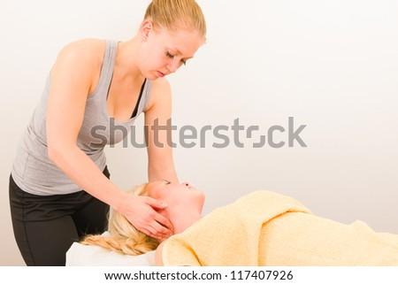 A masseur is massaging a customer's neck - stock photo