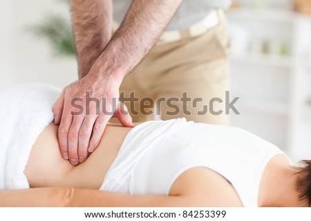 A masseur is massaging a woman