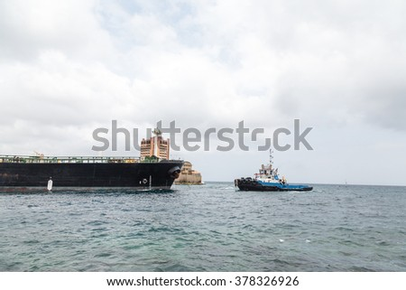 A massive tanker ship leaving the harbor on Curacao