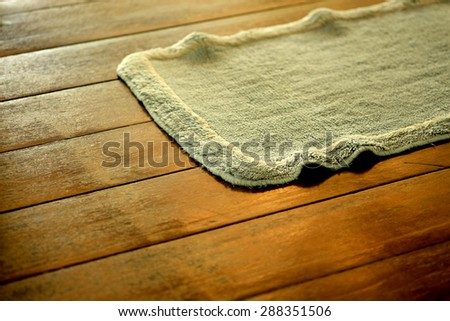 A mat placed in a doorway, on which people can wipe their shoes on entering a building. - stock photo