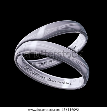 A matching pair of silver rings inscribed with You are my Forever-love on a black background - stock photo