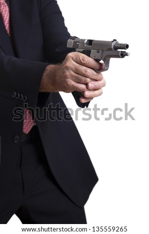 A mature adult man wearing a suit, holding a 9mm gun with both hands right in the middle of firing a shot, with the gun's latch in backwards position. Isolated on white background.