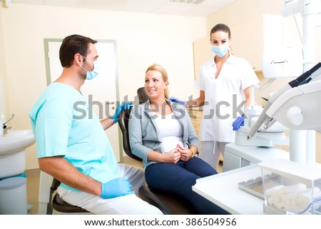 A mature adult woman getting a checkup at the Dentist.  - stock photo