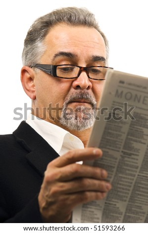 A mature man calmly and casually reading his newspaper. - stock photo