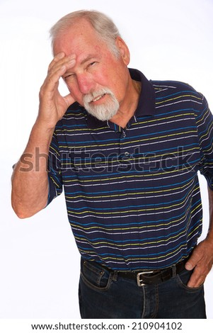 A mature man with a pained expression from a headache - stock photo