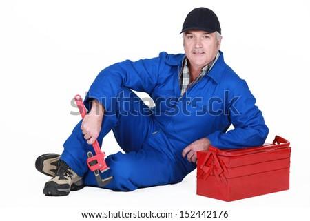 A mature plumber - stock photo