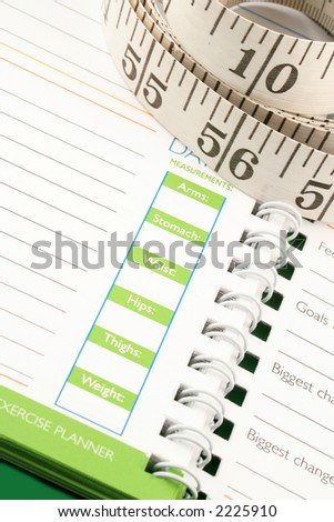 a measuring tape, diet and nutrition journal - stock photo