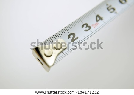 A measuring tape opened to about six inches long. - stock photo