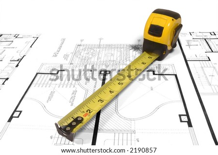 A measuring tape over a construction drawing of a house (design and drawings by the submitter) - stock photo
