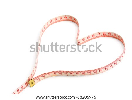 A measuring tape shaping a heart isolated on white background