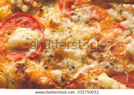 A meatless vegetarian pizza just removed from an oven - stock photo