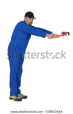 A mechanic with a wrench. - stock photo