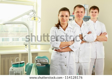 A medical doctors standing in dentist office - stock photo