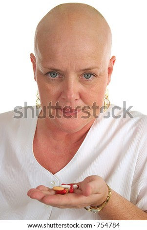 A medical patient having to take a handful of pills.  Isolated, closeup. - stock photo