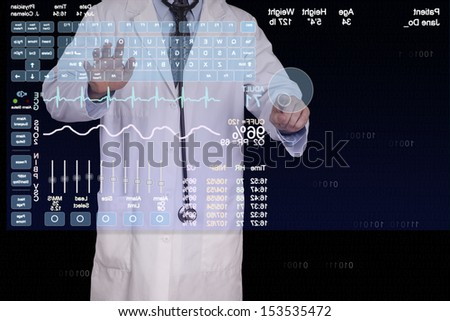 A medical professional using a virtual computer to enter a patients information.