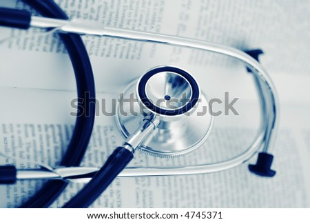 A medical tool - stethoscope on a open book