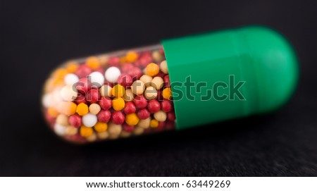 a medicine capsule, a super macro shot - stock photo