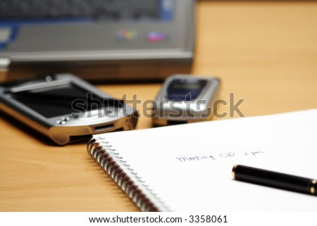A meeting reminder written in a notepad - stock photo