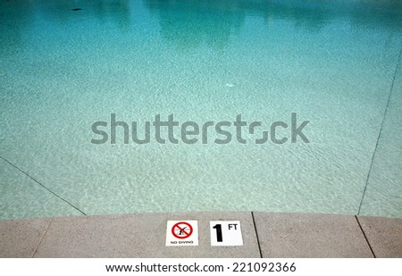 A Members Only Swimming Pool at a Private Club. Swimming Pools are loved and used by people around the world, to swim, play, exercise, and just cool off in the hot summer sun. Life is good at a pool. - stock photo