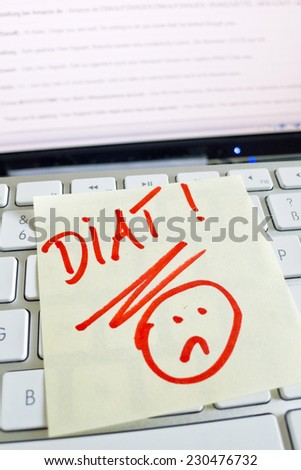 a memo is on the keyboard of a computer reminder: diet - stock photo