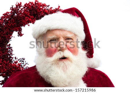 A Merry Holiday Santa, as he laughs a hearty Ho, Ho, HO. Head and shoulders close up on white. - stock photo